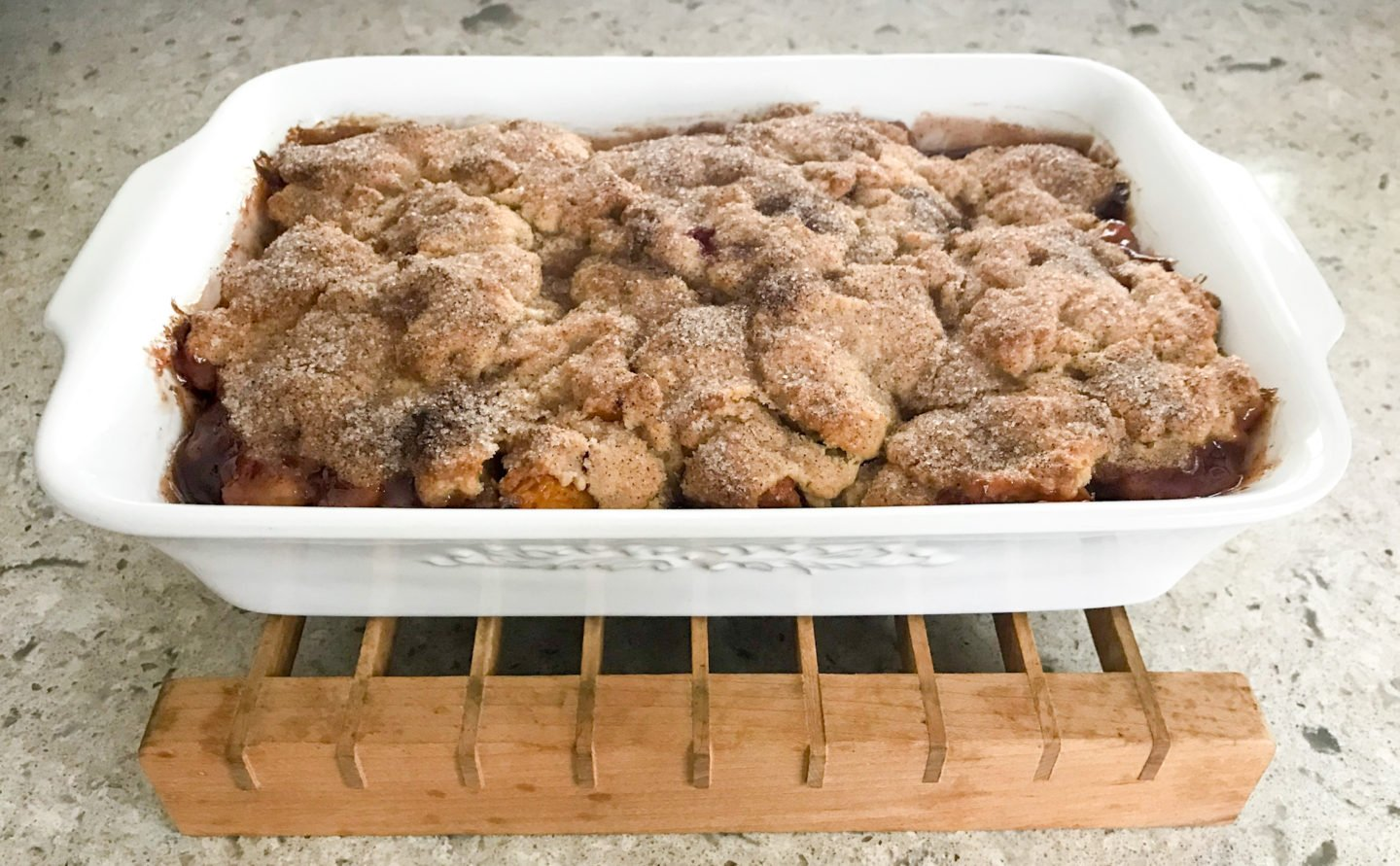 Bake your fresh peach cobbler until topping is golden, about 30 minutes.