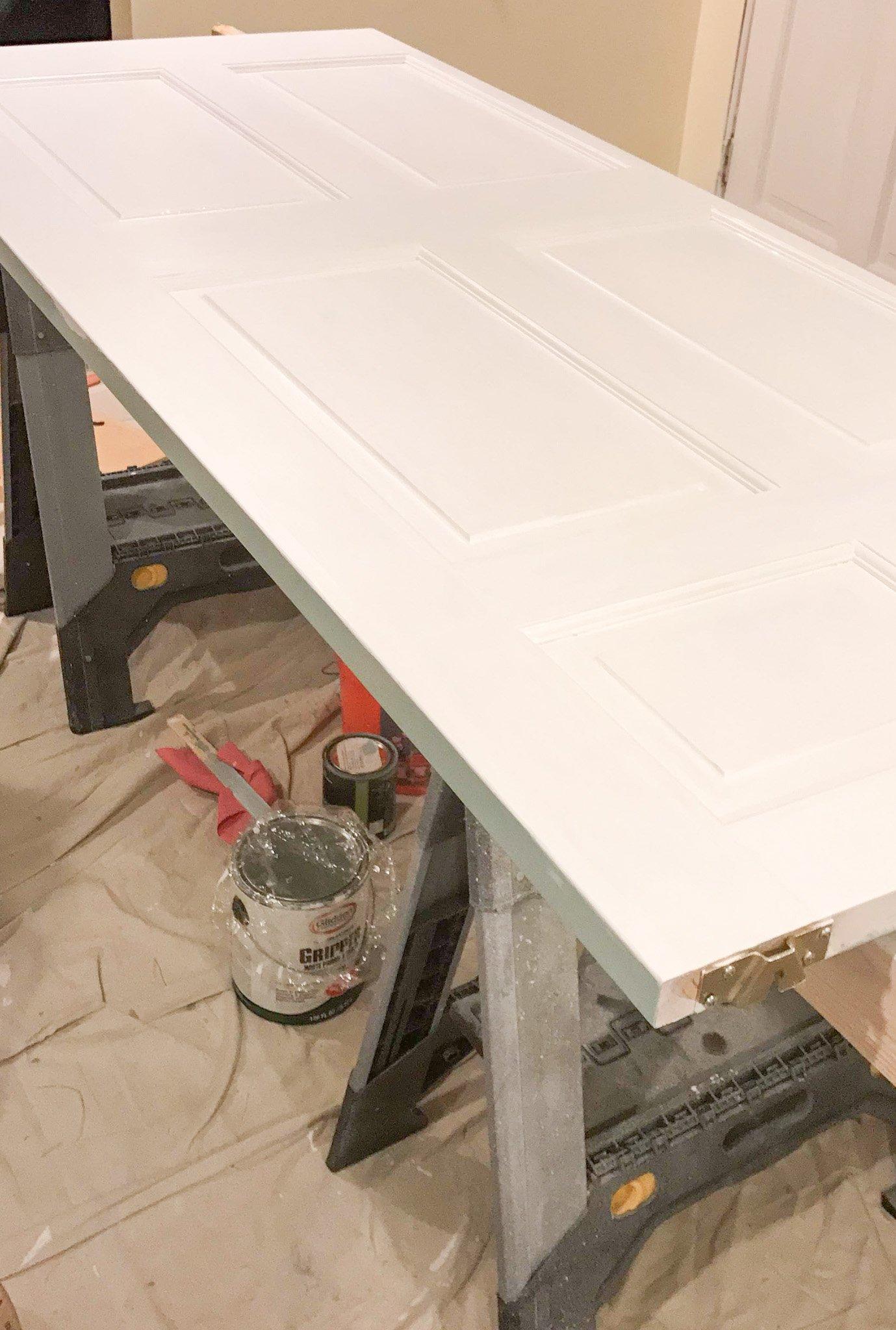 Step 7 in this door painting tutorial - apply primer.
